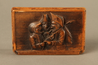 2016.184.42 top Rosewood snuff box with a carving of three Jewish hareskin dealers  Click to enlarge