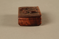2016.184.43 right side Carved rosewood snuff box with an image of three Jewish hareskin dealers  Click to enlarge