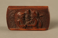 2016.184.43 top Carved rosewood snuff box with an image of three Jewish hareskin dealers  Click to enlarge