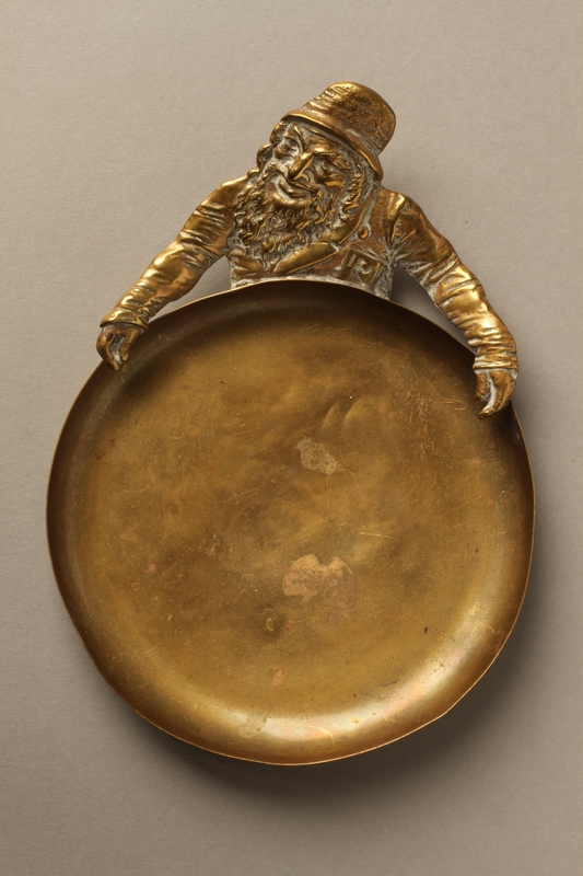 2016.184.46 front Cast brass figure of a Jew holding an ashtray