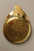 2016.184.46 back Cast brass figure of a Jew holding an ashtray  Click to enlarge