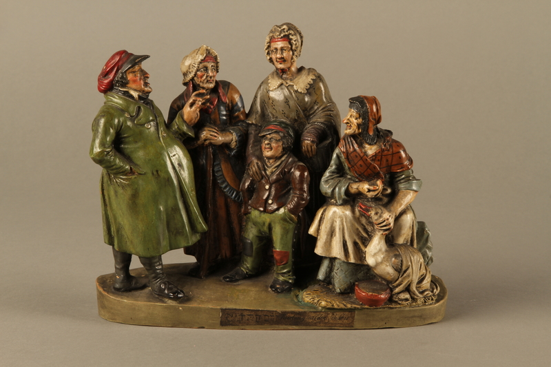 2016.184.49 front Colorful terracotta figure group of a Jewish family dressed for Sabbath