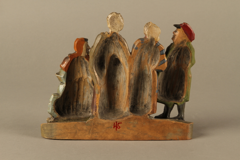 2016.184.49 back Colorful terracotta figure group of a Jewish family dressed for Sabbath