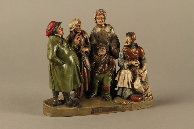 2016.184.49 right side Colorful terracotta figure group of a Jewish family dressed for Sabbath