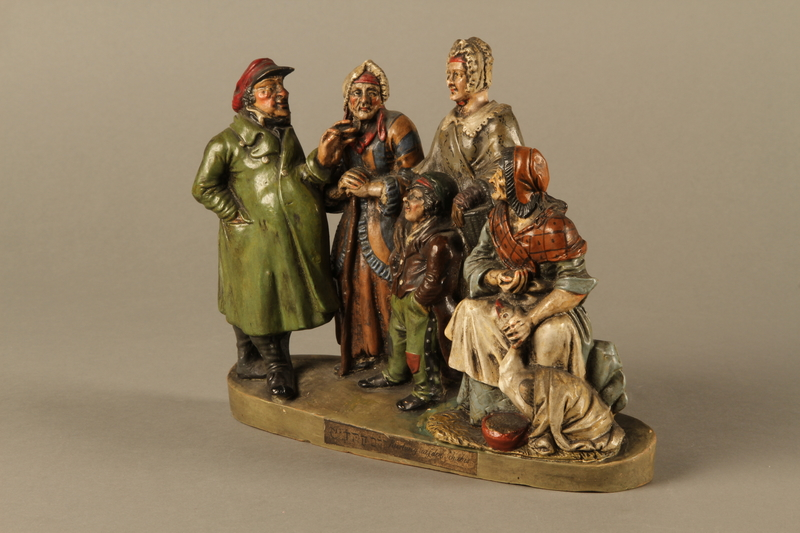 l2016.184.49 left side Colorful terracotta figure group of a Jewish family dressed for Sabbath