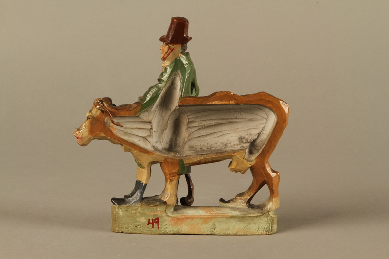 2016.184.53 back Terracotta figurine of a Jewish peddler with an underfed cow