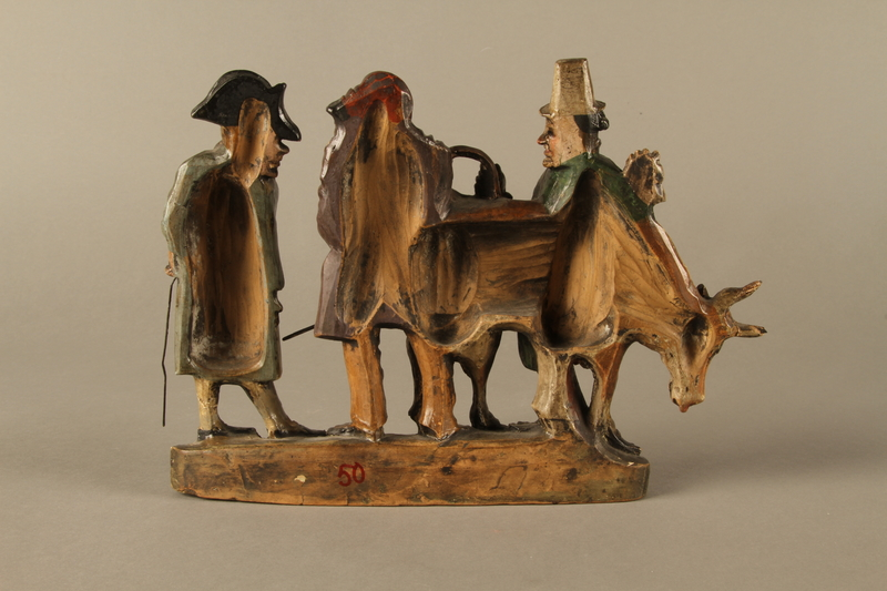 2016.184.54 back Terracotta figure group of 2 Jewish traders selling an old sagging cow