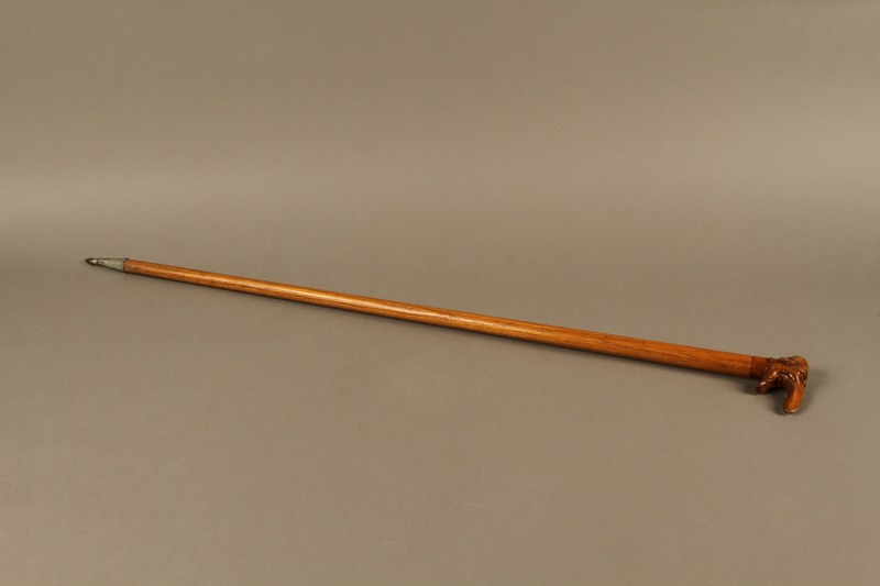 2016.184.55 right side Wooden cane with a grip shaped as a Jewish man's elongated nose