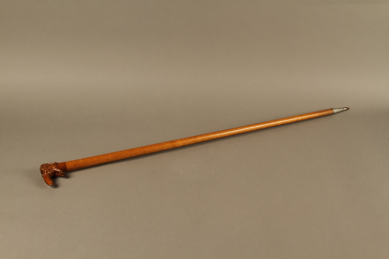 2016.184.55 left side Wooden cane with a grip shaped as a Jewish man's elongated nose
