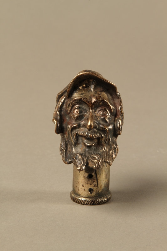2016.184.57 front Silver plated cane knob shaped as a Jewish man in cap with sidelocks