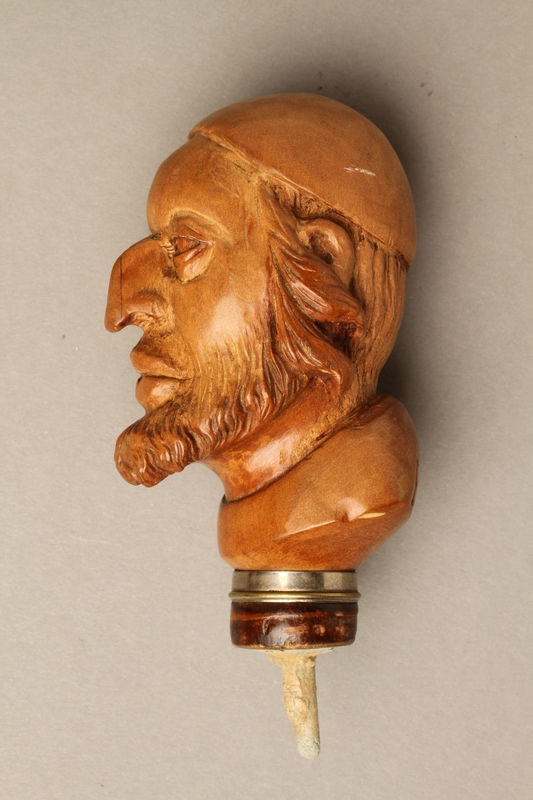 2016.184.59 left side Wooden walking stick knob carved as Fagin's head