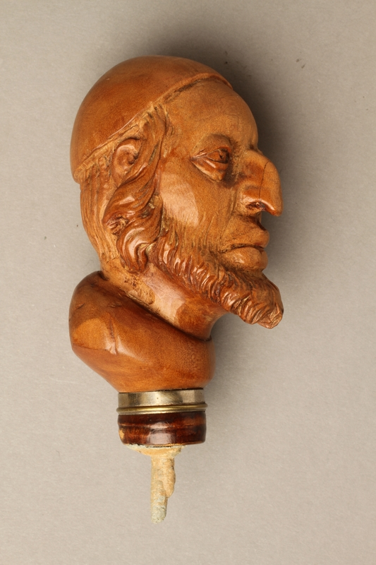 2016.184.59right side Wooden walking stick knob carved as Fagin's head