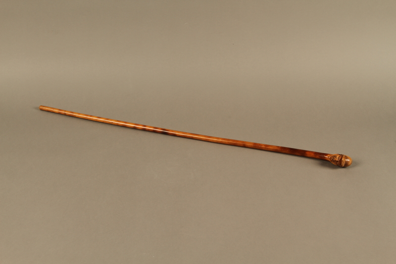 2016.184.62 right side Wooden cane with a carved grip of a Jewish man with painted eyes