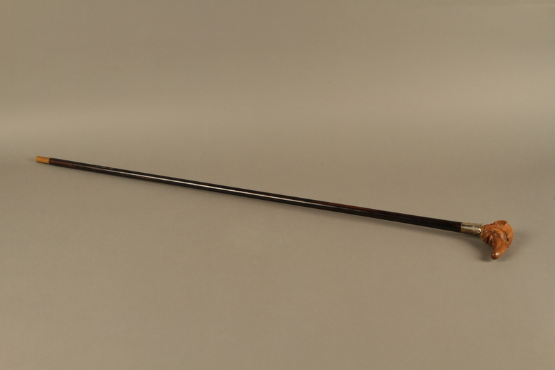 2016.184.64 right side Black wooden cane with a grip carved as a Jewish man's elongated nose