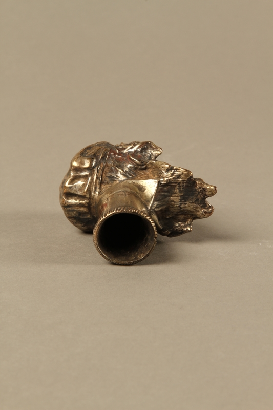 2016.184.66 bottom Bronze cane knob in the shape of a squinting Jewish man's head