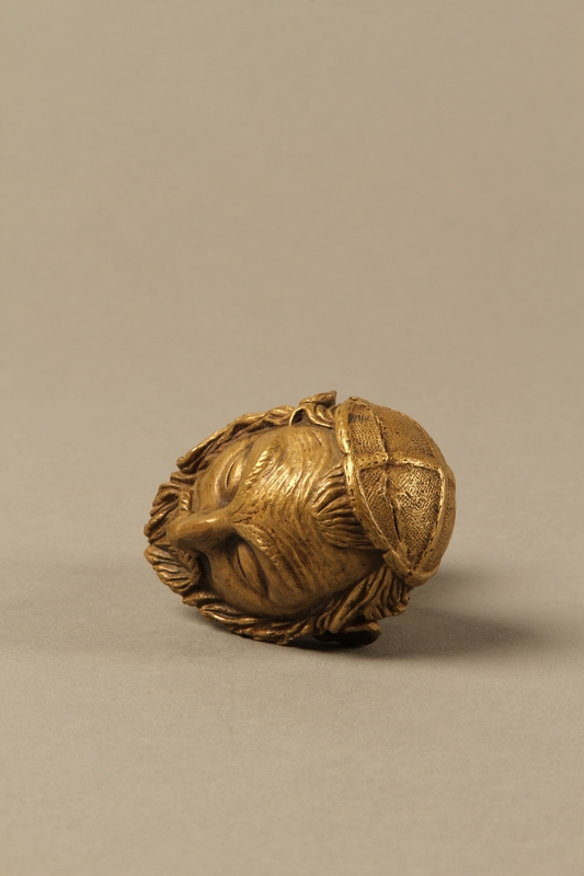 2016.184.66 top Bronze cane knob in the shape of a squinting Jewish man's head