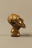 2016.184.66 right side Bronze cane knob in the shape of a squinting Jewish man's head  Click to enlarge
