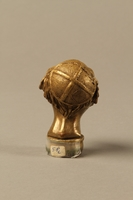 2016.184.66 back Bronze cane knob in the shape of a squinting Jewish man's head  Click to enlarge