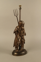2016.184.73_a-b right side Cast iron Fagin lamp holding a toasting fork / trident  Click to enlarge