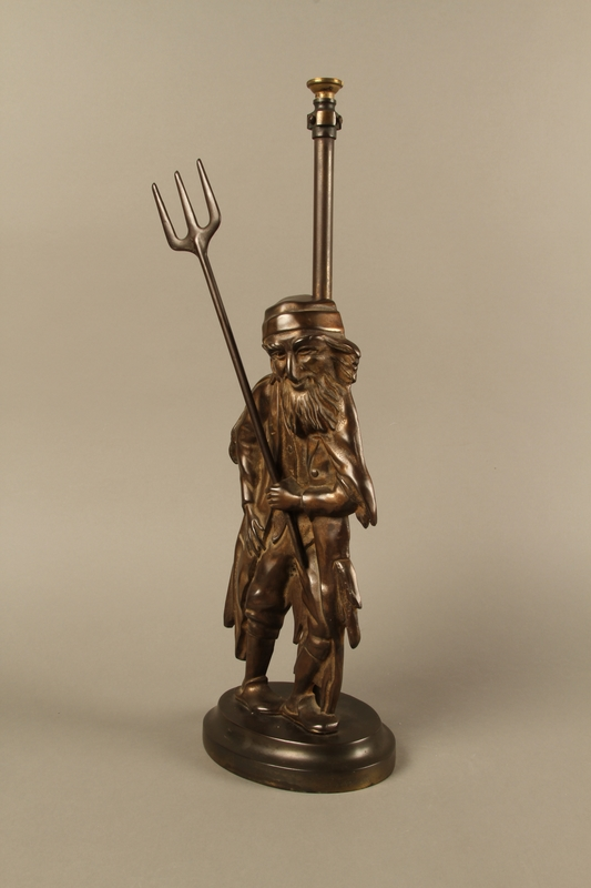 2016.184.73_a-b left side Cast iron Fagin lamp holding a toasting fork / trident