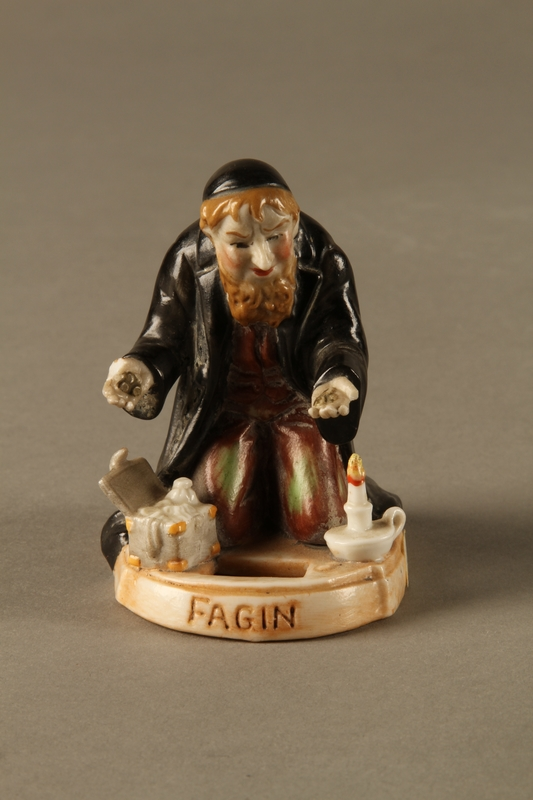 2016.184.74 front Porcelain figure of Fagin counting his money secretly at night