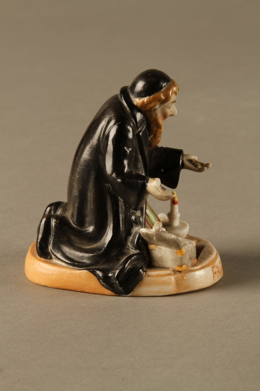 2016.184.74 right side Porcelain figure of Fagin counting his money secretly at night