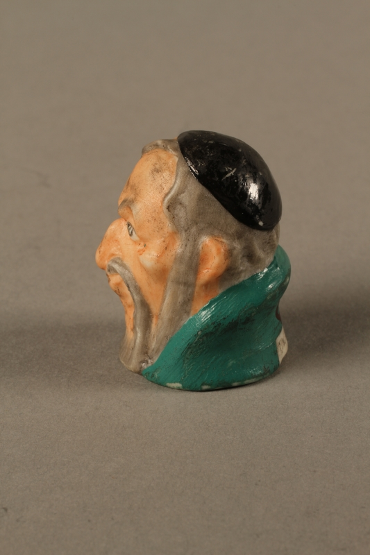 2016.184.75left side Thimble of Fagin's head by Harmer Sculptures