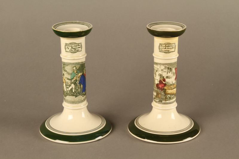 2016.184.77a-b front Pair of Adams stoneware candlesticks with scenes from Dickens