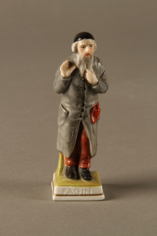 2016.184.80 front Porcelain figurine of a rosy cheeked Fagin