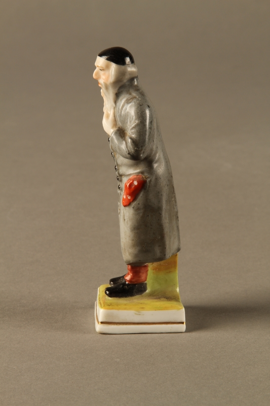2016.184.80 left side Porcelain figurine of a rosy cheeked Fagin