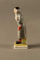 2016.184.80 left side Porcelain figurine of a rosy cheeked Fagin  Click to enlarge