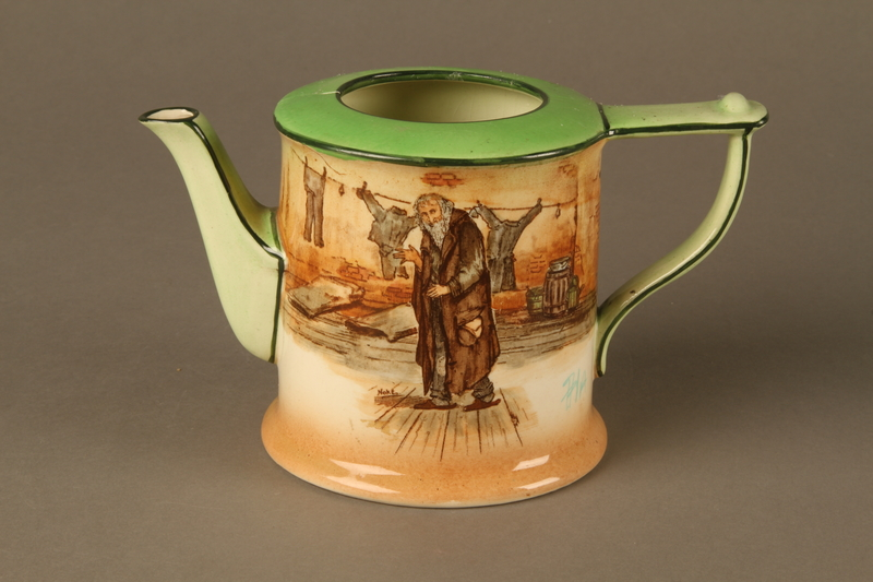 2016.184.83_a front Royal Doulton teapot with a painted image of Fagin