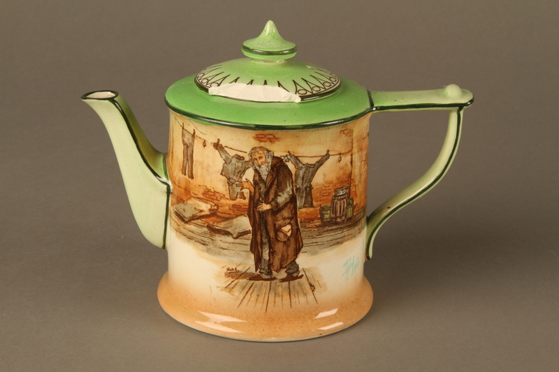 2016.184.83_a-b front Royal Doulton teapot with a painted image of Fagin