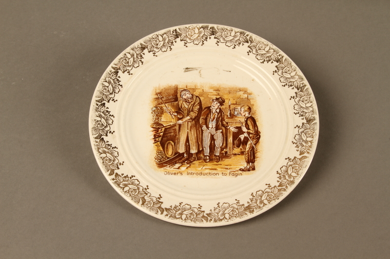 2016.184.87 front C&E plate with a scene of Oliver Twist, the Artful Dodger, and Fagin