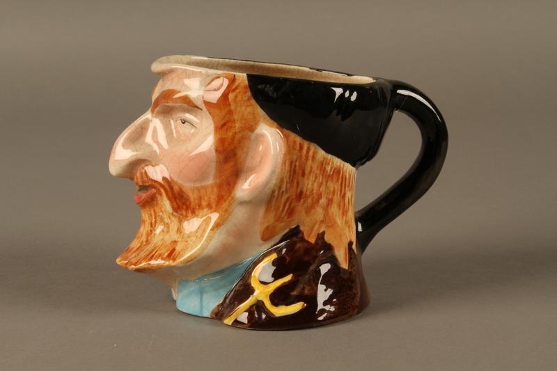 2016.184.88 left side Fagin ceramic mug by Avon Ware