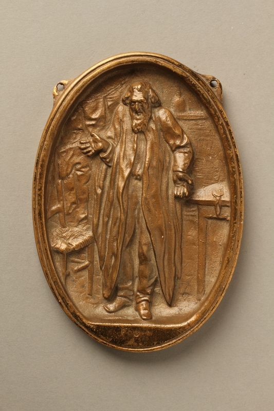 2016.184.93 front Bronze plaque with a full length image of Fagin