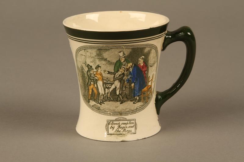 2016.184.97  front Porcelain mug with a scene of Oliver Twist meeting Fagin