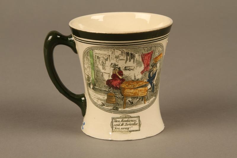 2016.184.97 back Porcelain mug with a scene of Oliver Twist meeting Fagin