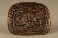 2016.184.99  front Copper painted metal dish with bas relief of 3 Jewish men on a bench  Click to enlarge
