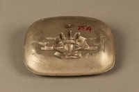 2016.184.101 back Silver colored iron dish with bas relief of 3 Jewish men on a bench  Click to enlarge