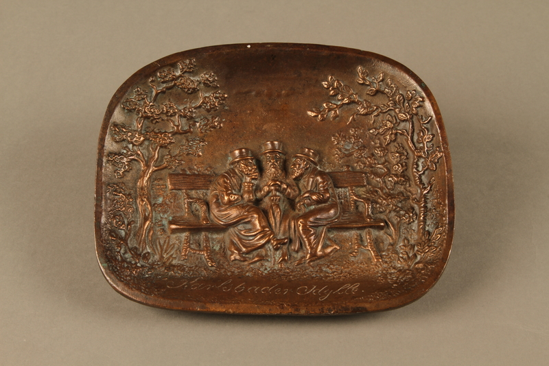 2016.184.100 front Bronze dish with bas relief of 3 Jewish men on a bench