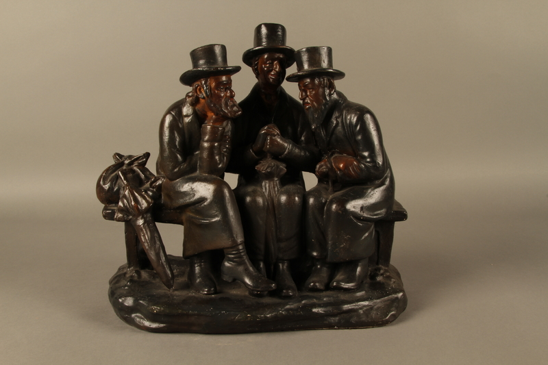 2016.184.102 front Hand painted metal figure group of 3 Jews on a bench with their umbrellas