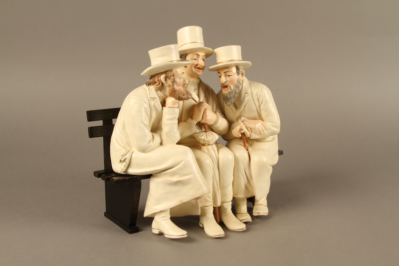 2016.184.103_a-b right side White painted white ceramic group of 3 Jews on a bench with their umbrellas
