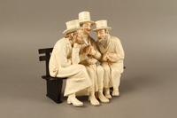 2016.184.103_a-b right side White painted white ceramic group of 3 Jews on a bench with their umbrellas  Click to enlarge