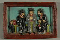 2016.184.104 front Hand painted ceramic relief of 3 Jews on a bench with their umbrellas  Click to enlarge