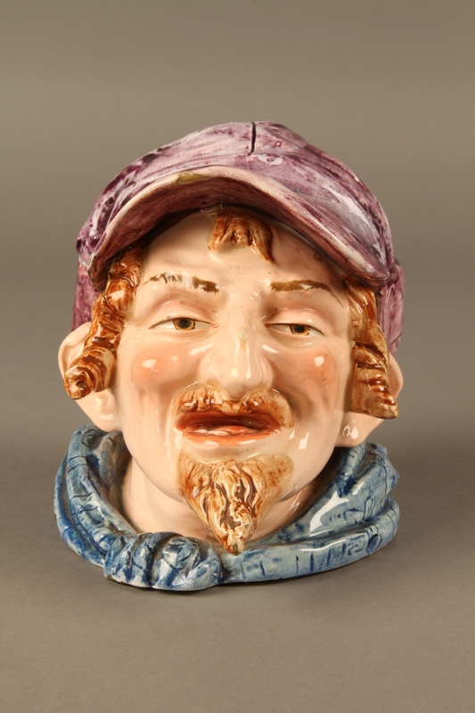 2016.184.105_a-b front Porcelain tobacco jar with lid shaped as the head of a Jew