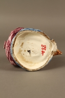 2016.184.105_a-b bottom Porcelain tobacco jar with lid shaped as the head of a Jew  Click to enlarge