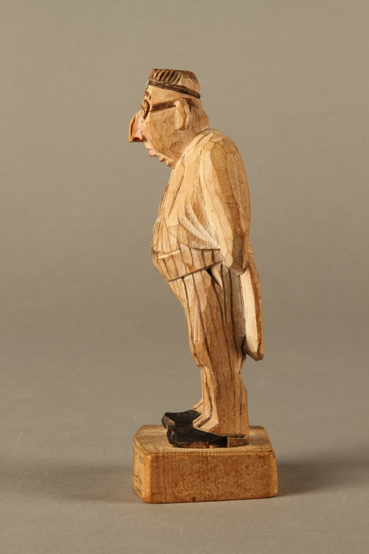 c6bf0d7de7a ... 2016.184.106 left side Carved wooden figure of a Jewish doctor in white  coat and ...