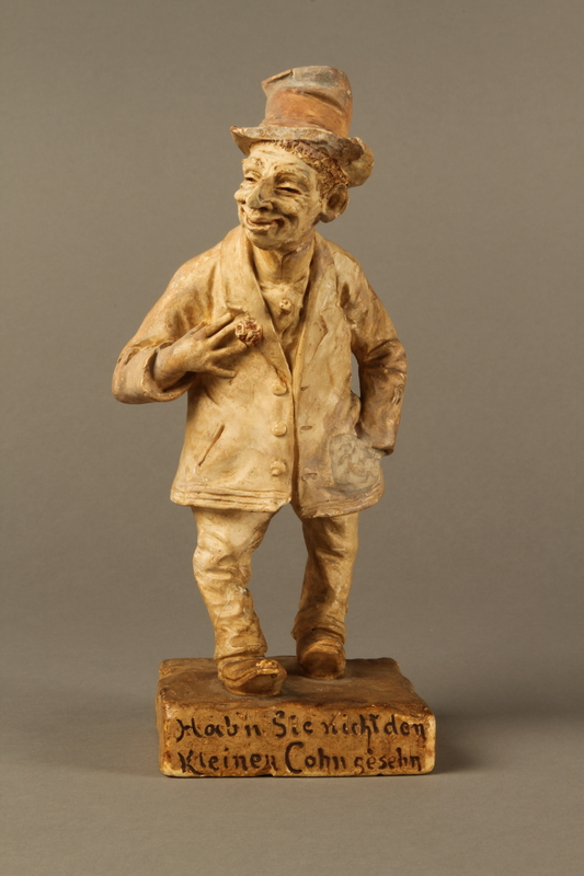 2016.184.108 front Ceramic figurine of a Jewish man with a boutonniere