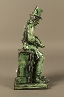 2016.184.109 right side Green ceramic figurine of a Jewish peddler counting his money  Click to enlarge